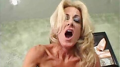 Appealing mature blondie taking two cocks at once
