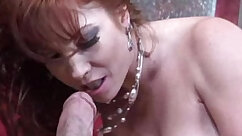 Busty redhead rides a hard cock on the couch