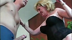 Brunette granny banging young boy